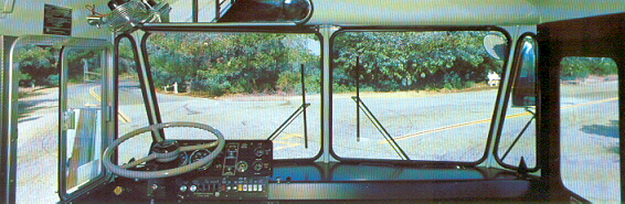 A view looking out the windshield from the driver's area of a Crown Supercoach.